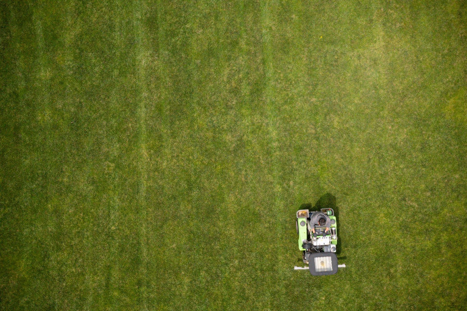 Lawn care technician applying fertilizer
