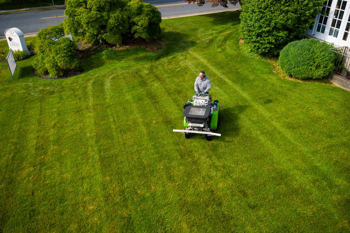 Lawn care technician spraying liquid fertilizer