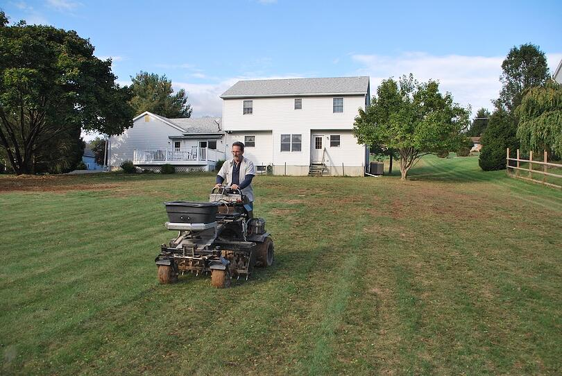 Pictures showing how a lawn aerating service and seeding can transform an ugly yard.