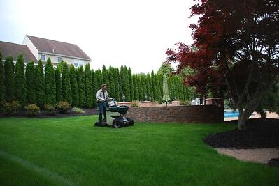 lawn care professional applying seed