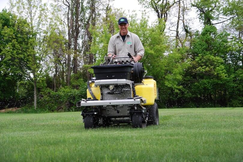 lawn care technician applying crabgrass control