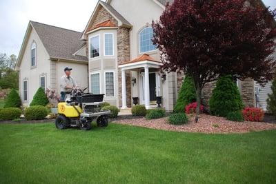 lawn care service technician treating lawn