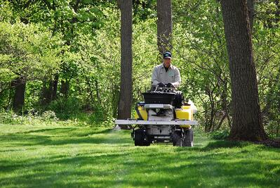 lawn care company applying weed control
