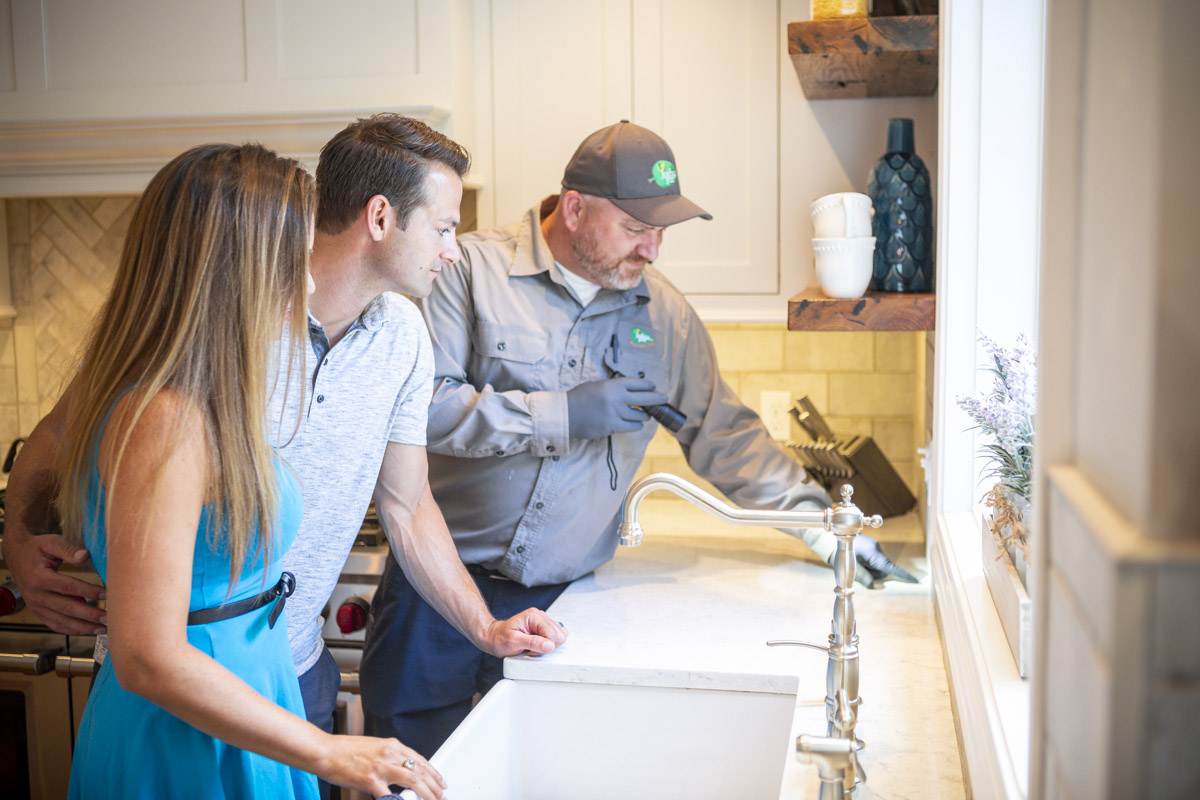 pest control technician working with customers