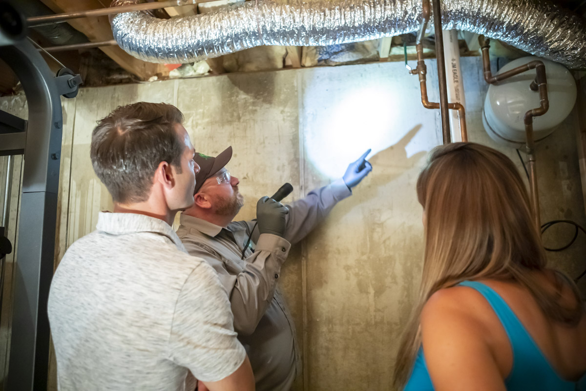 Pest Control technician inspecting with customers their interior space