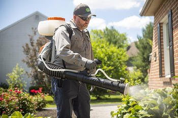 Joshua Tree pest control technician spraying for mosquitoes