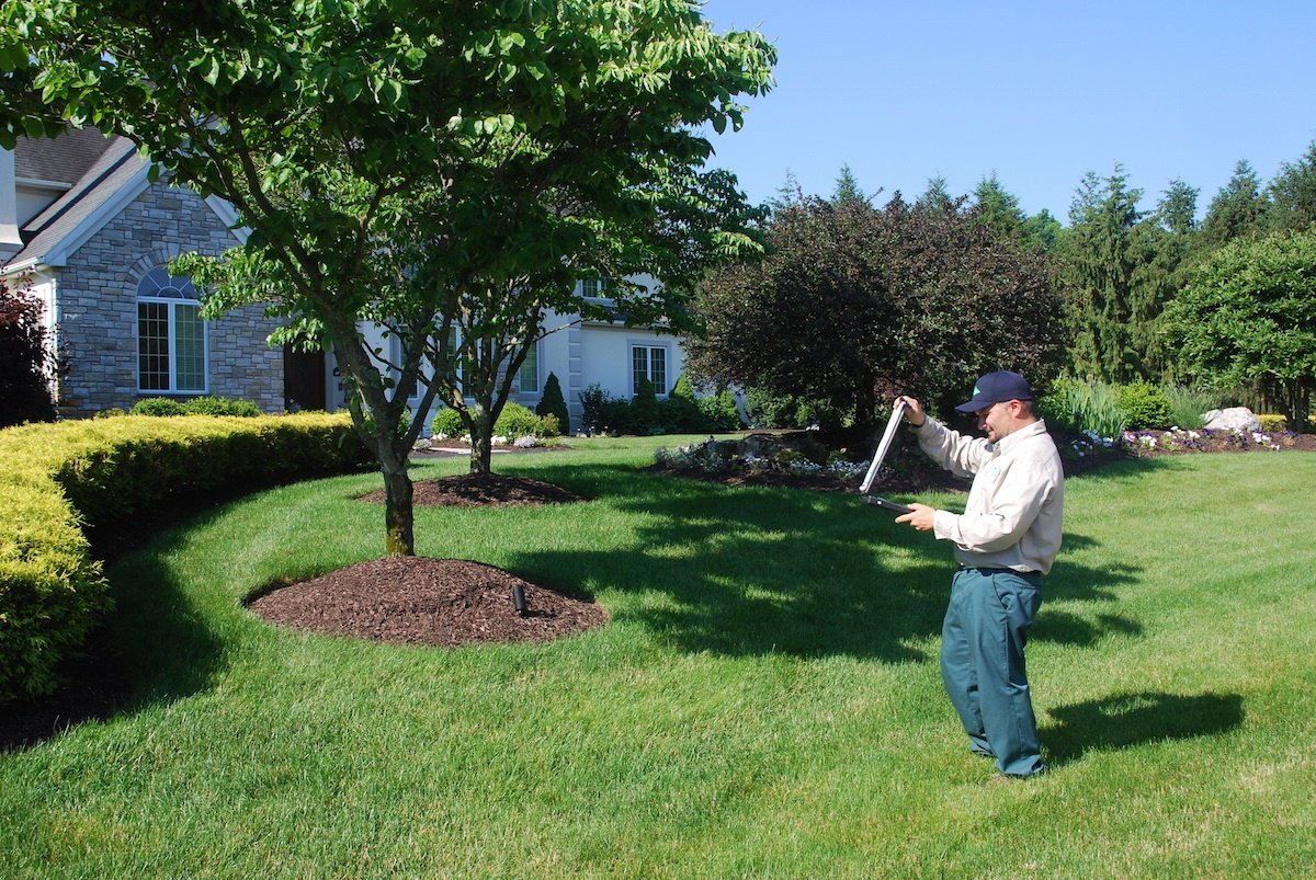 Lawn Care technician performing soil test