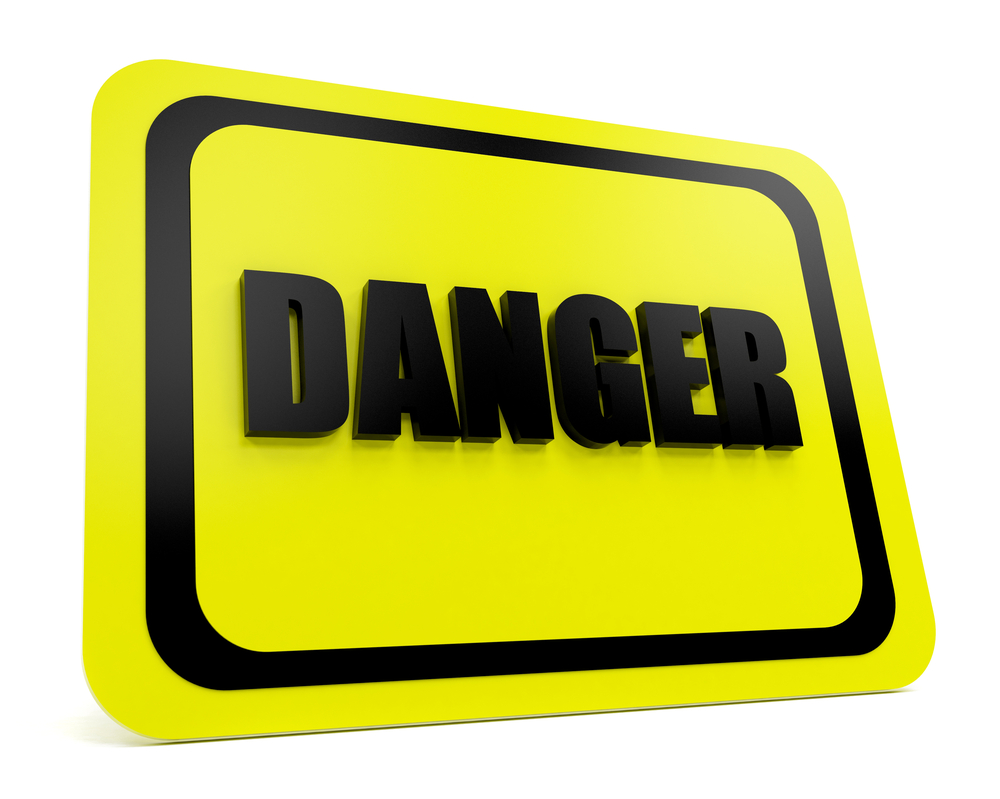 Yellow-black danger sign over a white background