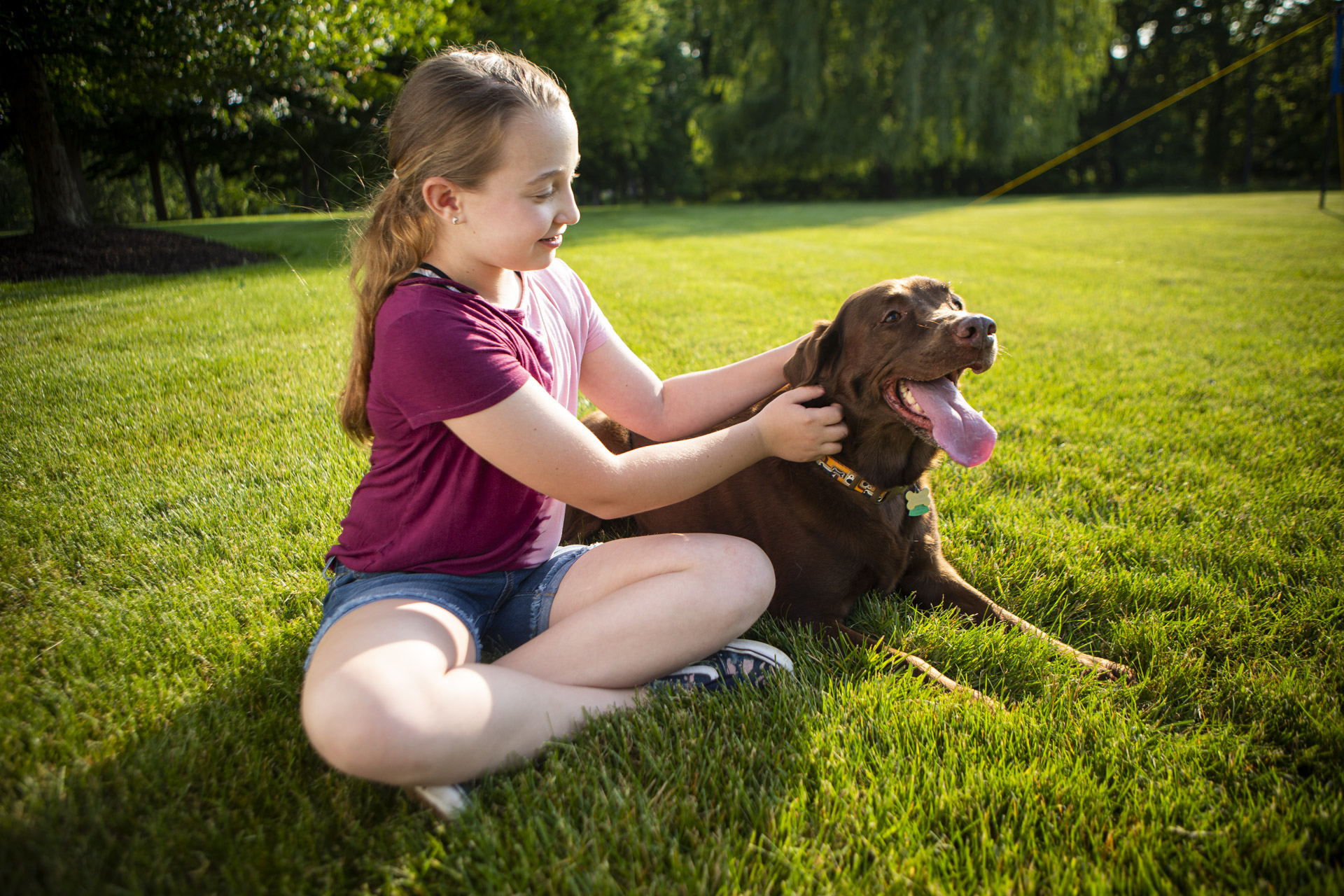 Child and dog in yard with tick control
