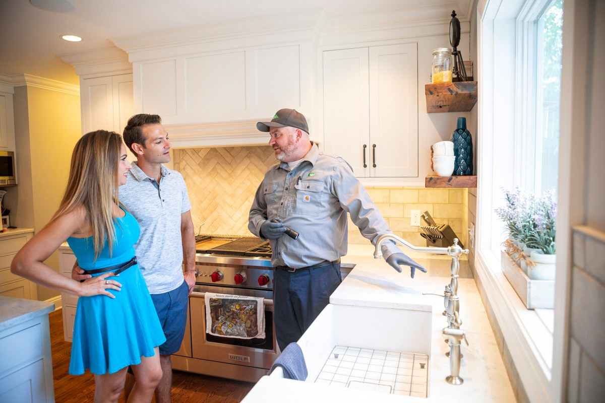 Pest control service specialist in kitchen in Lehigh Valley, PA