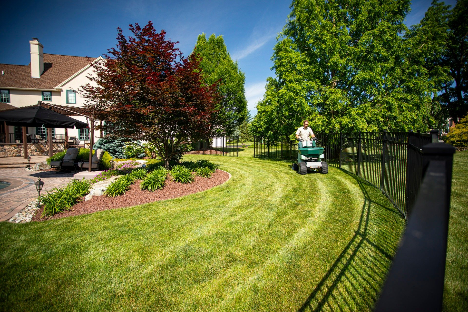 Lawn care technician caring for lawn in Easton, PA